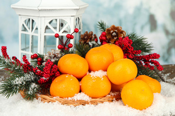 Christmas composition with ripe tangerines on bright background