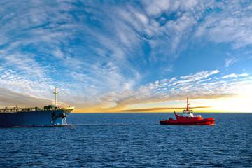 Maritime Tugboat Pulling a Cargo Ship on a Sea.