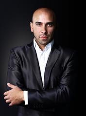 Cool businessman standing on dark gradient background