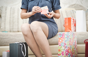 Girl with purchases. Woman with packages from the store.