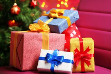 Christmas gift boxes on Christmas tree background