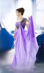Garden Poster beautiful woman in bright purple wedding dress posing
