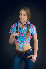 blonde in a plaid shirt with a gun