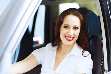 Young woman in car