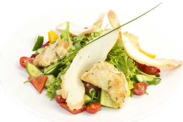 salad of meat cheese and vegetables in a restaurant
