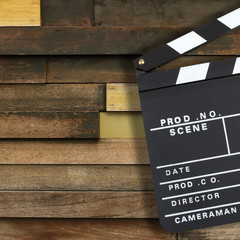 Movie production clapper board over vintage wooden background