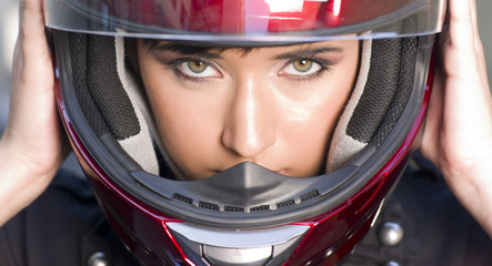 Attractive Girl Positions Red Full Face Helmet Before Motorcycle