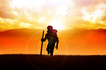 Silhouette of a man figure trekking on the hills