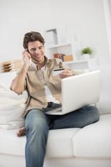 man at phone paying online ordering