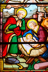 The nativity of Jesus by mosaic glass.