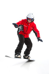 Full length shoot of Skillful male snowboarder jumping.