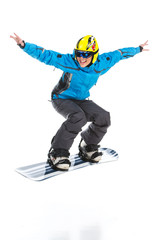 Female skillful snowboarder jumping raising hands up.