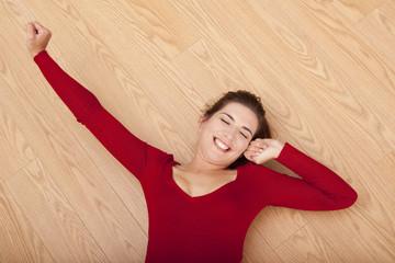 Happy woman on the floor