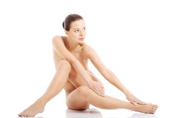 Beautiful naked woman sitting.