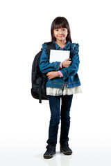 Little asian girl standing and holding books