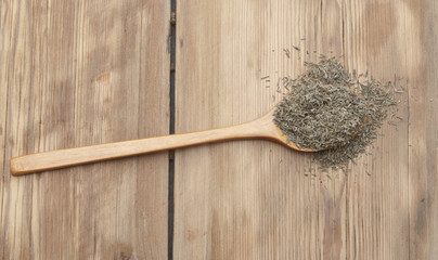 Thyme in wooden spoon