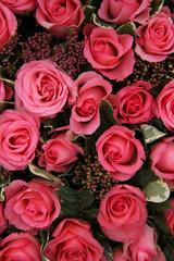 Skimmia and pink roses bridal arrangement