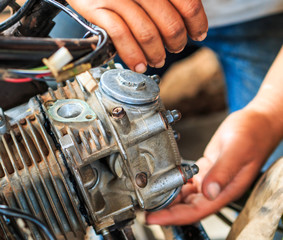 Technician fixs motorcycle machine