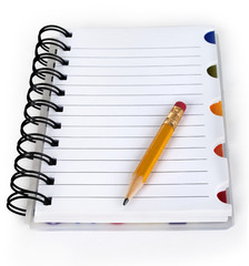 pencil and notebook isolated on a white background