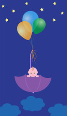 baby in an umbrella on balls
