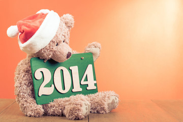 Teddy Bear and New Year date for greeting card