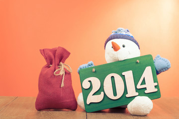 New Year greeting card with snowman and gift bag