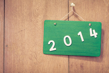 New Year date signboard on wood background