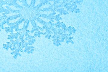 Beautiful snowflake on snow