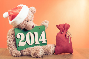 New Year card with Teddy Bear and gift bag