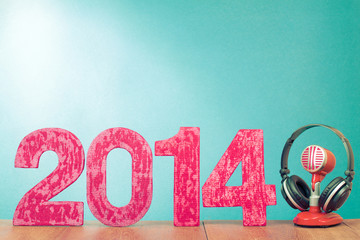 New Year greeting card with retro microphone and headphones