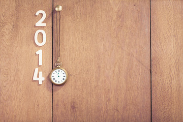 New Year date, pocket watches hanging on wooden wall