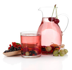 Pitcher and glass of compote with summer berries isolated