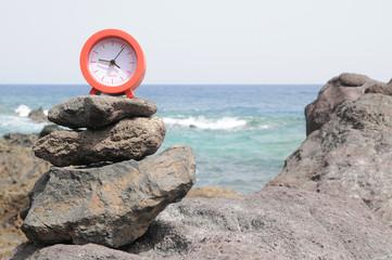 Red Clock Near the Ocean