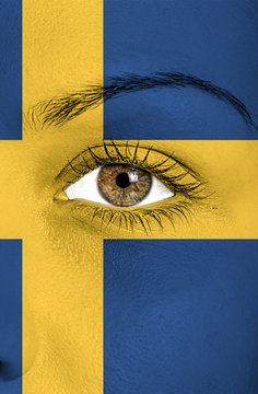 sweeden flag painted over female face