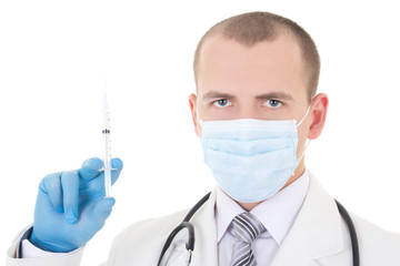 portrait of young doctor in mask with syringe isolated on white