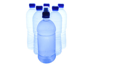 Bottled mineral water over white background