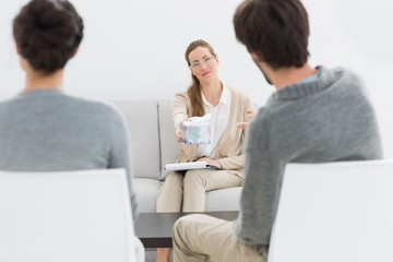 Female financial adviser in meeting with couple