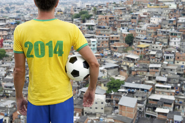 Brazil 2014 Football Player Standing with Soccer Ball Favela Rio