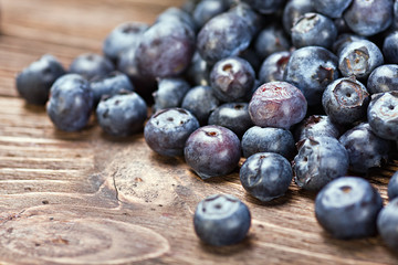 blueberries on old wooden table background. Shallow depth of fie