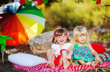Two little girls with watermelon outdoors