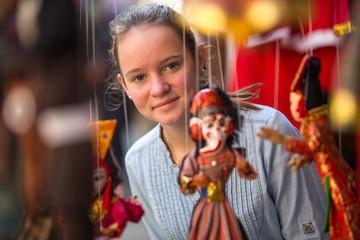 Teen-girl in a Indian souvenir shop.