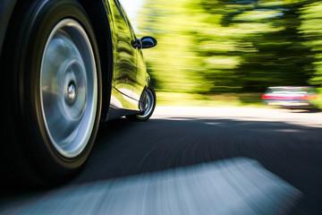 Fototapete - Rear side view of luxury sedan in turn.