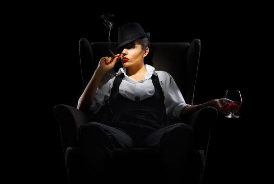 Mafiosi woman with cigar and brandy glass