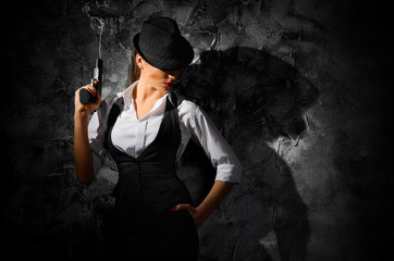 Dangerous and beautiful criminal girl with gun