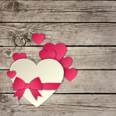 Heart with a bow on a wooden background vector