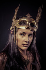 Valkyrie, Golden statue concept. Arty portrait of model with gol