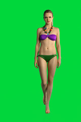Girl posing against a removable green chroma key background