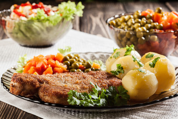 Breaded cutlet and potatoes