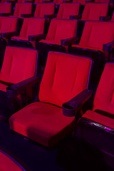 Rows of empty theater seats