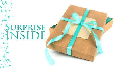 Present box tied with ribbon, isolated on white